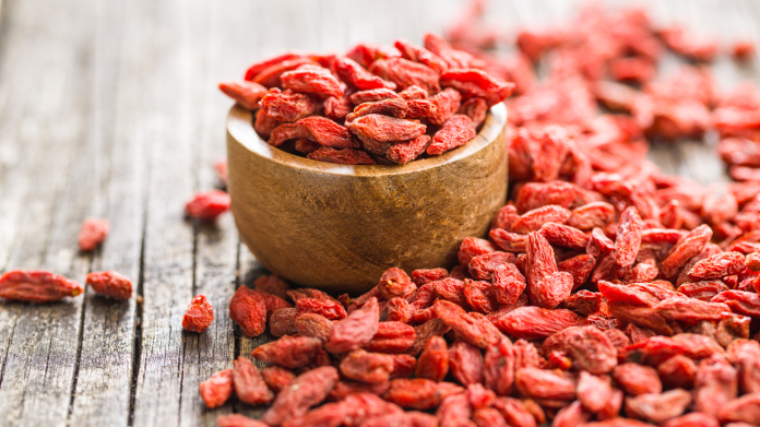 Small bowl of dried goji berries on a table