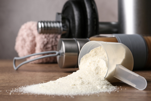 whey protein powder and weights
